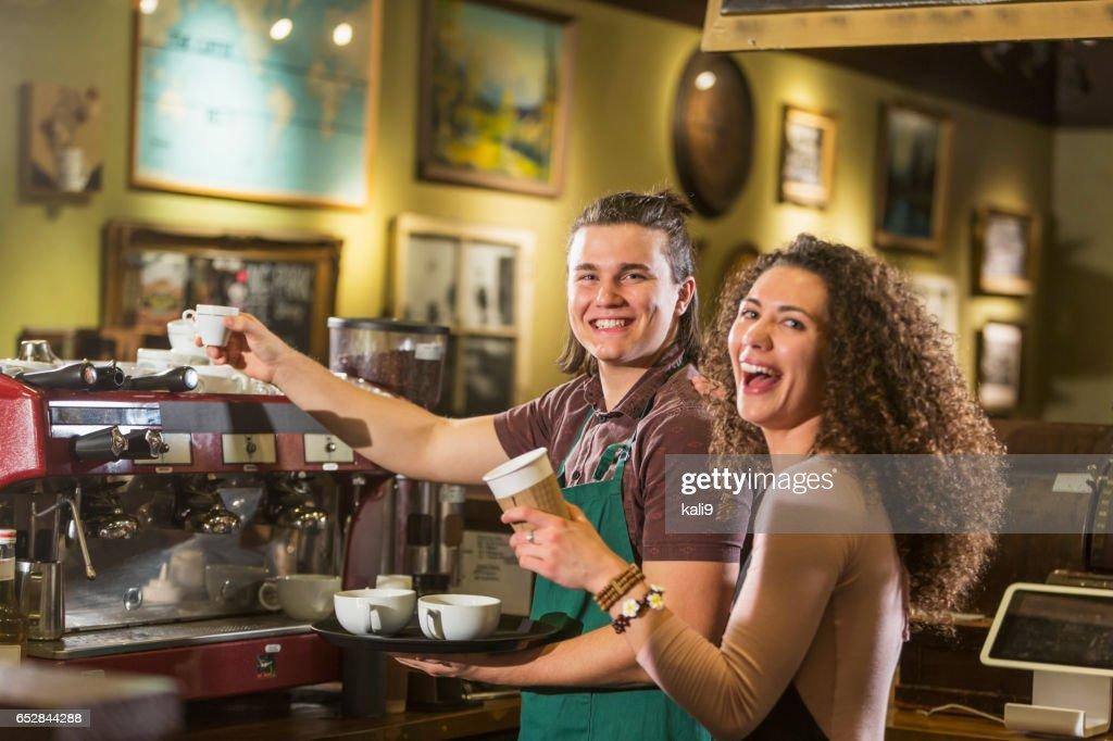 Two workers in a coffee shop : Bildbanksbilder