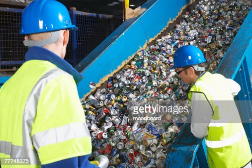Two Workers in Recycling Center