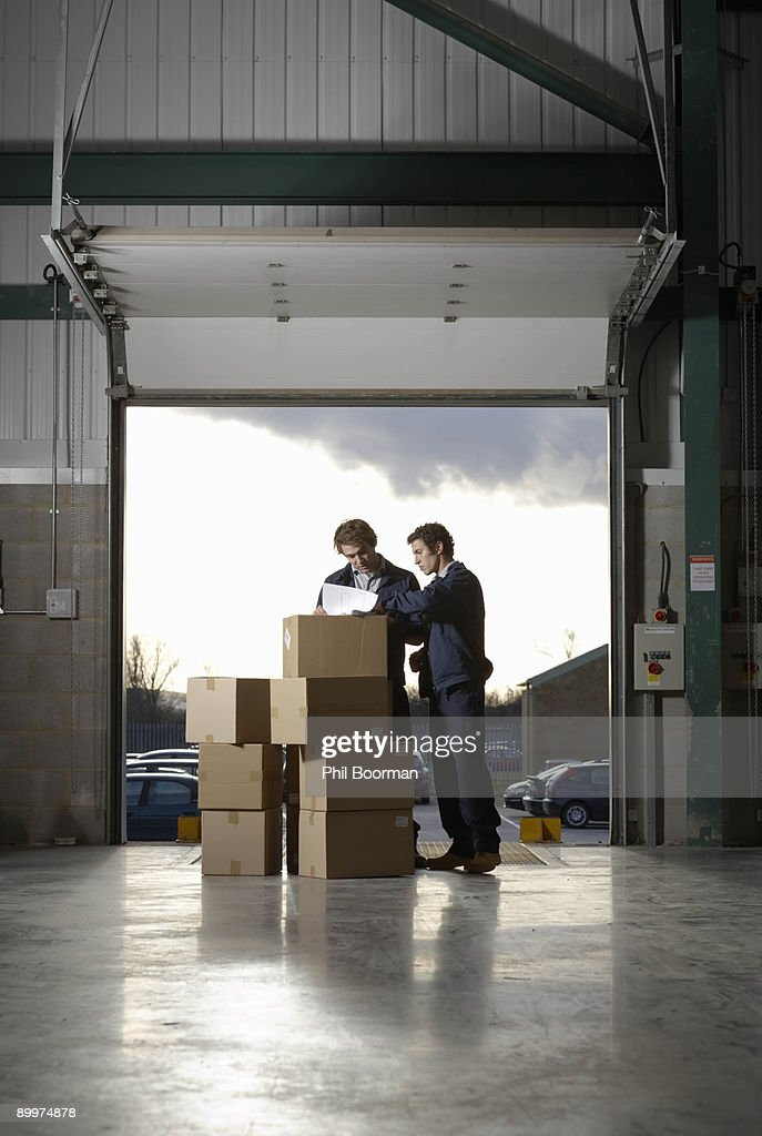 Two workers in warehouse : Stock Photo