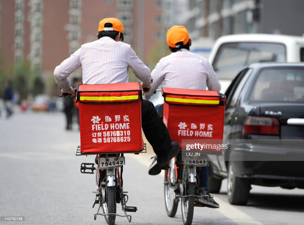 Two workers ride bicycles to deliver fast food in Beijing on April 12, 2012. A new World Bank report projects GDP growth in China will be 8.2 percent in 2012 and 8.6 percent in 2013. The China Quarterly Update, released April 12, says that the prospects for a gradual adjustment of growth remain high.