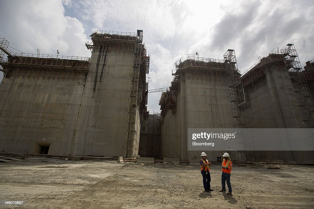 Two workers talk at the construction site for the third sets of locks on the Pacific side of the Panama Canal near Panama City, Panama, on Thursday, April 24, 2014. Panama's presidential contenders are winding down their campaigns ahead of the May 4 election as a strike by construction workers paralyzes the expansion of the country's signature waterway, its biggest economic resource. Photographer: Susana Gonzalez/Bloomberg via Getty Images