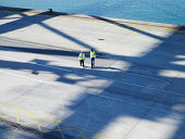 two workers talking in harbour seen from above
