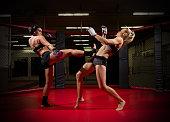 Two wrestler women in sports hall