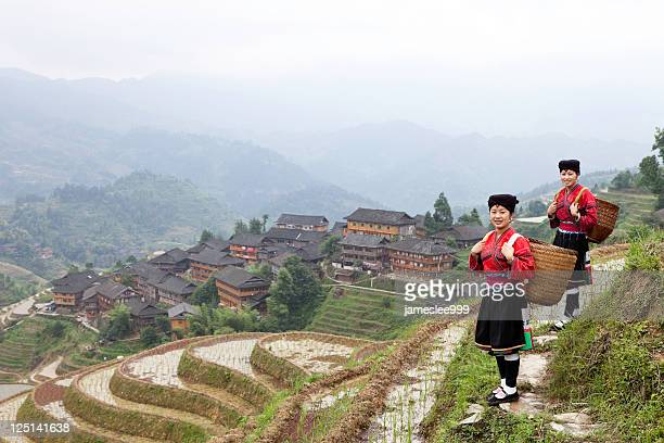 Two Yao ethnic minority with a view of a village