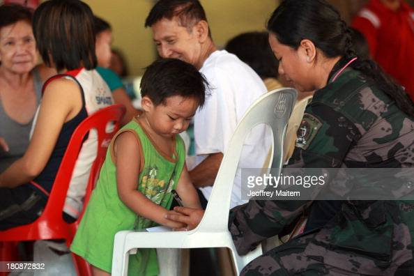 A two year old boy is seen after they were rescued by state security forces following from Muslim rebels an assault on September 17 2013 in the...