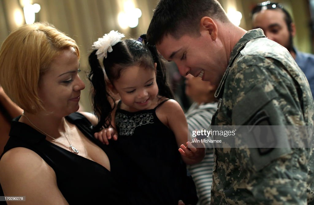 Two year old Yoselin Lopez (C), held by her mother <a gi-track='captionPersonalityLinkClicked' href=/galleries/search?phrase=Jennifer+Lopez&family=editorial&specificpeople=201784 ng-click='$event.stopPropagation()'>Jennifer Lopez</a> (L), inspects a Purple Heart awarded to her father, U.S. Army Specialist Arael Lopez-Lopez (R), following a Purple Heart ceremony at Mount Vernon June 10, 2013 in Mount Vernon, Virginia. The U.S. Army celebrated its 238th birthday at the home of George Washington with a ceremony that included the awarding of the Purple Heart for three soldiers wounded in Afghanistan. Lopez received his injuries from an RPG explosion followed by a dismounted IED in Wardak Province on August 8, 2012.