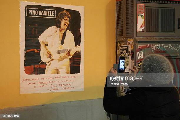 Two years after the death of Pino Daniele fans gathered in Piazza Santa Maria la Nova gathering to pay homage to the artist under the installation...