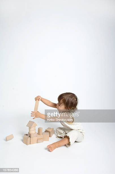 Two Years Old Baby Playing With Wooden Blocks