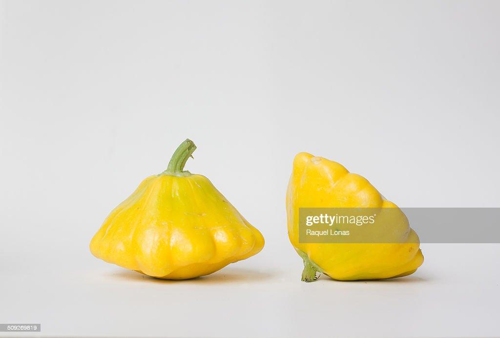 Two yellow pattypan squash