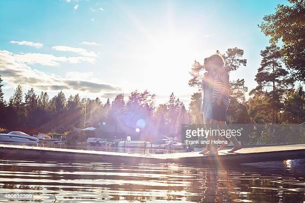 Two young adult men walking along pier, Gavle, Sweden