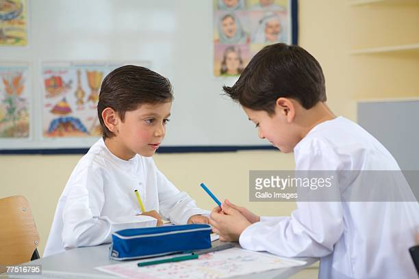 Two Young Arab Boys Working in a Classroom. Dubai, United Arab Emirates