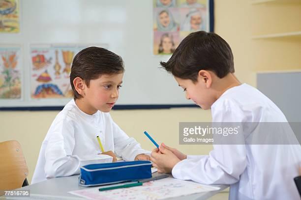 Two Young Arab Boys Working in a Classroom. Dubai, United Arab Emirates