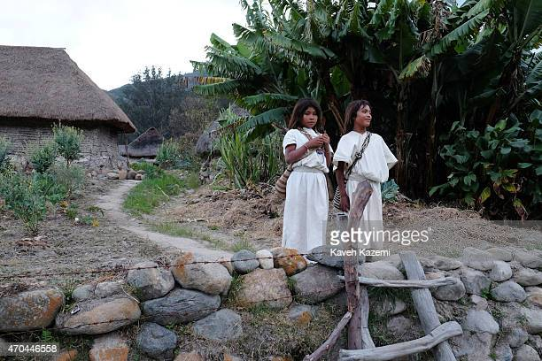 Two young Arhuacos stand by the ladder which is put in place in front of the village walls for people to cross and prevent animals crossing on...