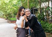 Two young Asian girls having fun outdoors