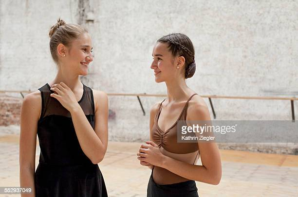 two young ballet dancers in rehearsal room