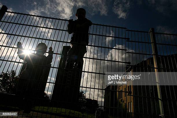 Two young boys climb on a fence in a street in the Govan neighborhood on September 30 2008 in Glasgow Scotland The latest reports by the campaign to...