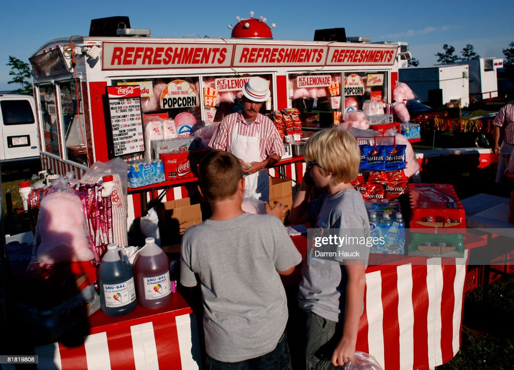 Two young boys get refreshments during a July Fourth fireworks show on the shore of Lake Michigan July 3 2008 in downtown Milwaukee Wisconsin The...