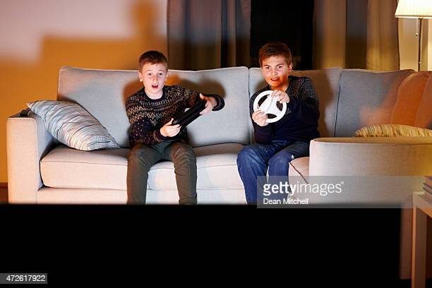 Two young boys having fun playing video games