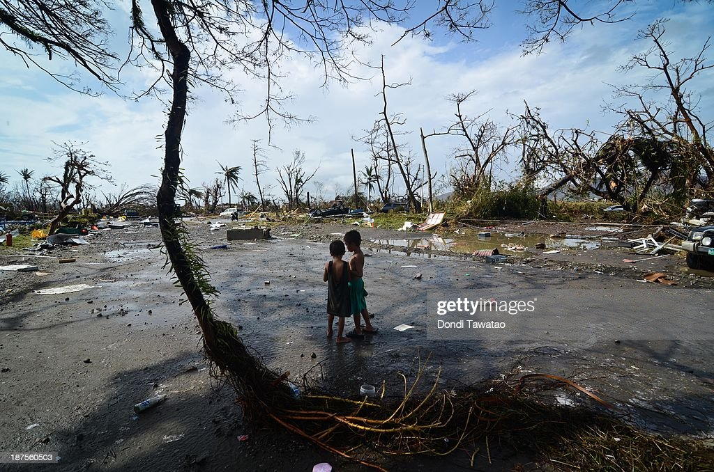 Two young boys look at the devastation in the aftermath of typhoon Haiyan on November 10 2013 in Tacloban City Leyte Philippines Typhoon Haiyan...