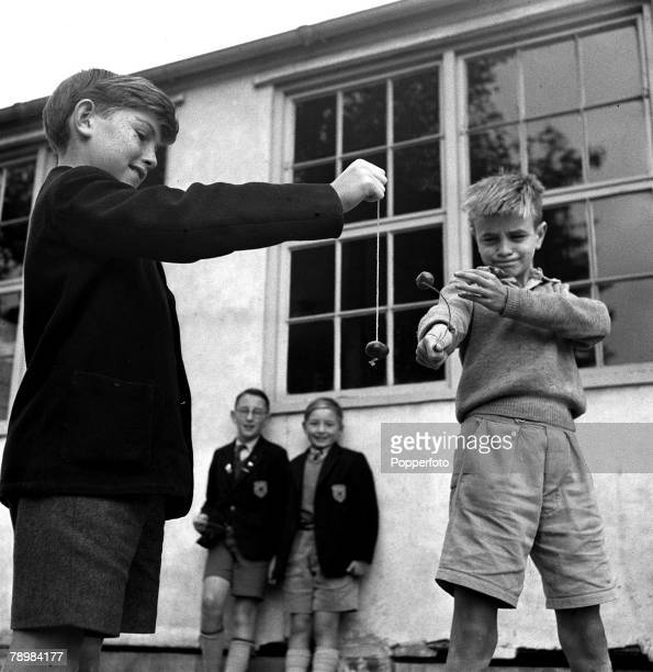 1955 Two young boys play conkers in the school playground