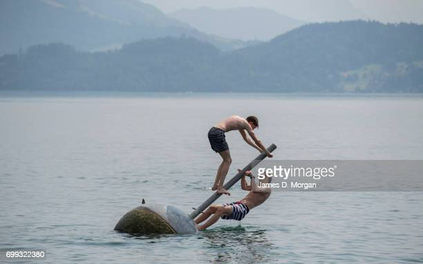 Two young boys play on the lake enjoying the hot weather on the longest day of 2017 on June 21 2017 in Zug Switzerland The summer solstice was...