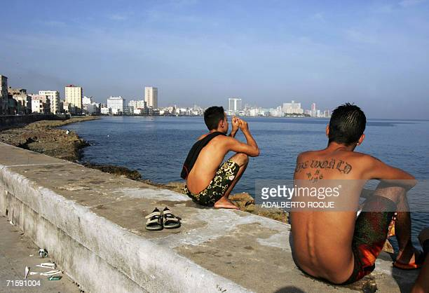 Two young boys sit at Havana's Malecon in the early morning on August 5th 2006 Exactly 12 years ago in 1994 a group of opponent of the Cuban...