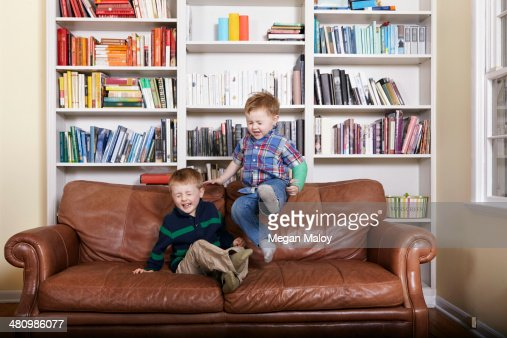 Jumping On Couch Stock Photos And Pictures Getty Images
