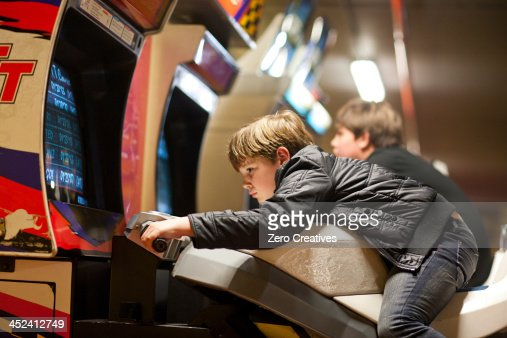 Two young brothers playing on driving video games