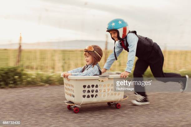 Two Young Business Boys Racing on Skateboard