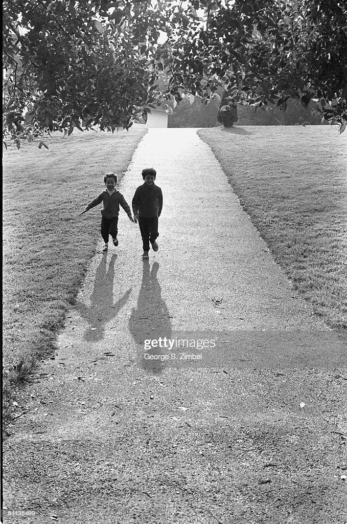 Two young children (Jodi and Ike) enjoying a walk through a garden in Quebec, 1969.