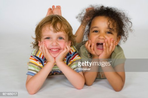 Two Young Chldren One Interracial Girl Laughing Together : Stock Photo