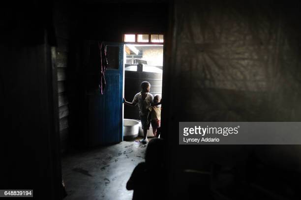 Two young Congolese boys stand in the doorway of an orphanage in Goma North Kivu province Democratic Republic of the Congo on Nov 28 2008 Roughly 50...