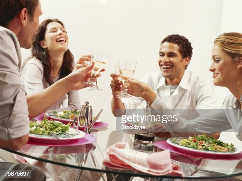 Two young couple toasting with wine at restaurant : Stock Photo