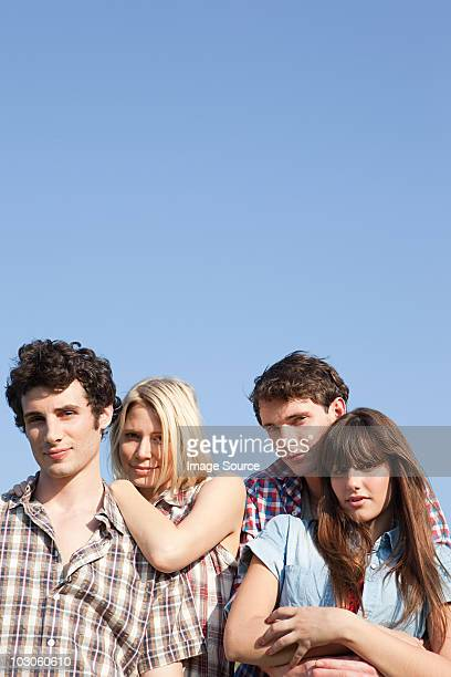 Two young couples and blue sky