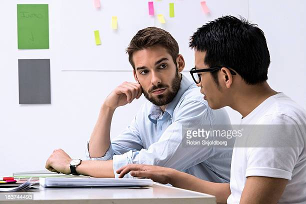 Two young designers discussing ideas