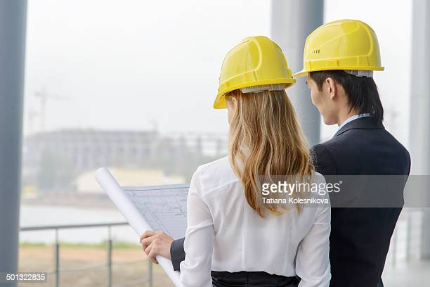 Two young designers on construction site