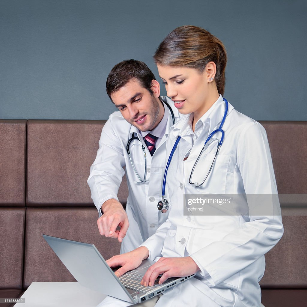 Two young doctors : Stock Photo