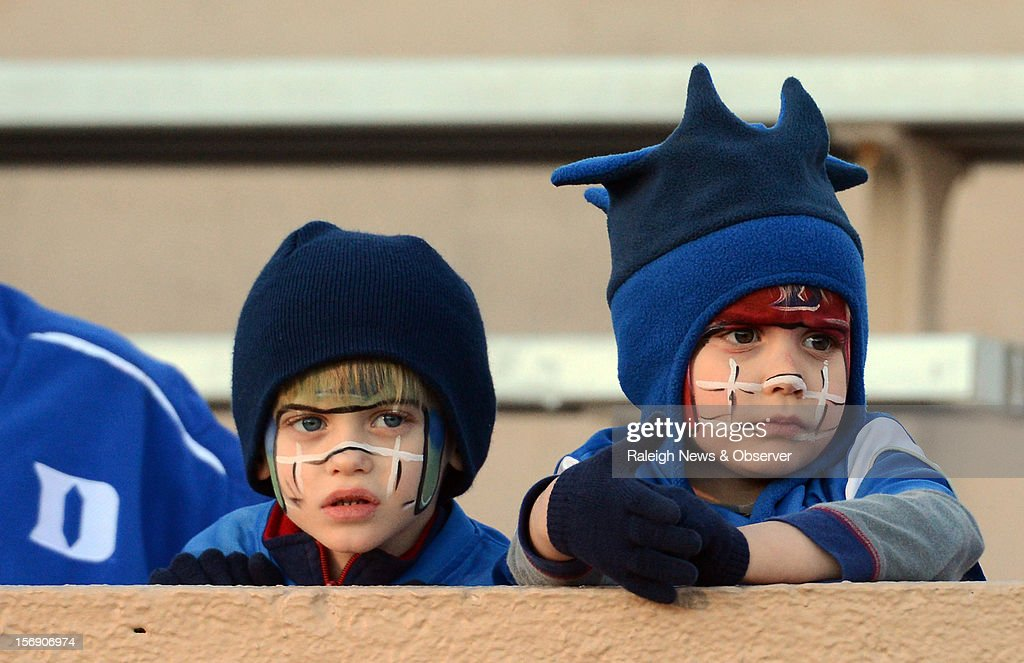 Two young Duke fans watch as their Blue Devils leave the field after Miami defeated Duke 52-45 at Wallace Wade Stadium on Saturday, November 24, 2012, in Durham, North Carolina.