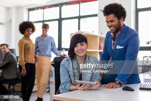 Two young entrepreneurs in a new startup business : Stock Photo