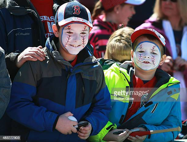 Two young fans had their faces painted like baseballs before the game The Boston Red Sox hosted the Milwaukee Brewers in an MLB regular season game...
