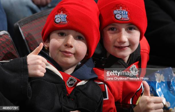 Two young fans ham it up for Hockey Day in Canada during an NHL game between the Ottawa Senators and the New York Rangers at Canadian Tire Centre on...
