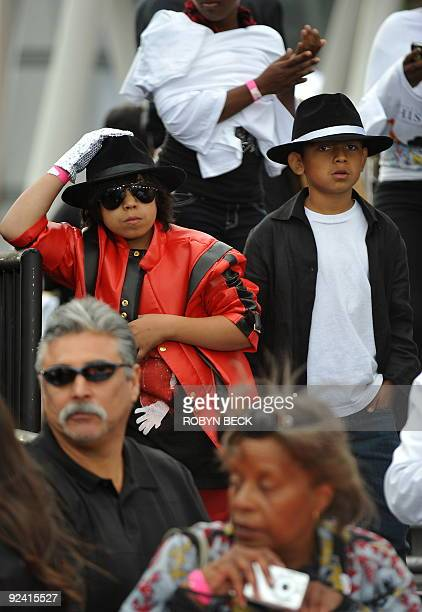 Two young fans in Michael Jackson outfits watch celebrities on the red carpet for the world premiere of the Michael Jackson�s �This is it� at the...