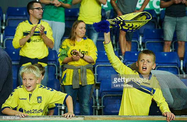 Two young fans of Brondby IF celebrate after the UEFA Europa League qualifier match between Brondby IF and Hibernian FC at Brondby Stadion on July 21...