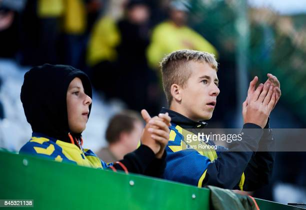 Two young fans of Brondby IF cheer during the Danish Alka Superliga match between OB Odense and Brondby IF at EWII Park on September 10 2017 in...