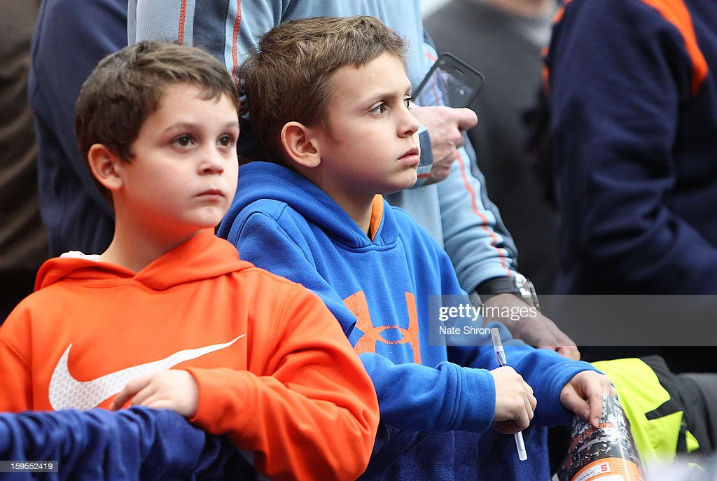Two young fans of the Syracuse Orange look on as they await autographs before the game against the Villanova Wildcats at the Carrier Dome on January 12, 2013 in Syracuse, New York.
