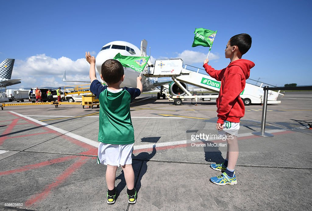 Two young fans wave as the Northern Ireland football team make their training camp departure at George Best City Airport on May 30, 2016 in Belfast, Northern Ireland. Northern Ireland have qualified for the Euro 2016 football championship finals in France, the first time the province has qualified for an international football tournament final since 1986.