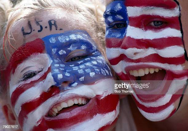 Two young female fans of the United States Olympic team celebrate with faces painted with stars and stripes during the 1992 Summer Olympics in...