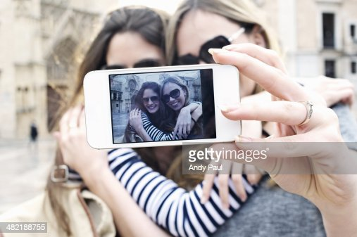 Two young female friends taking a self portrait, Valencia, Spain