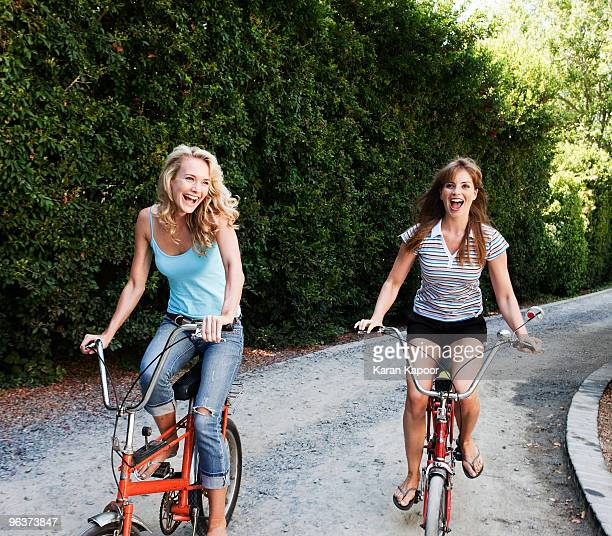 Two young females on cycles