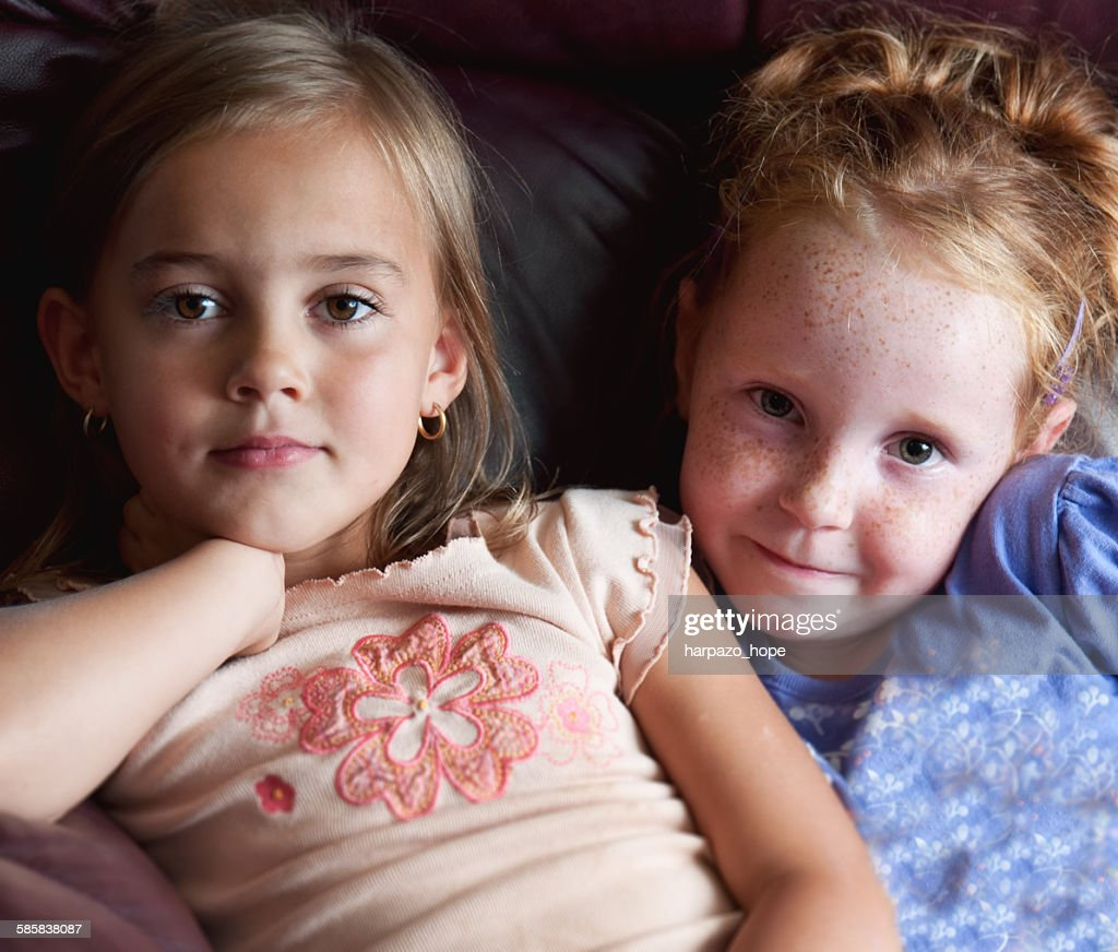 Two young friends on a couch